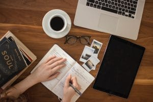 how to get more traffic to your website - open notebook on desk with laptop and coffee
